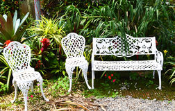 Chairs and benches in garden Royalty Free Stock Photography