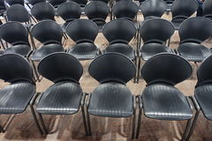 Chairs. Black chairs lined up in a conference room royalty free stock photos