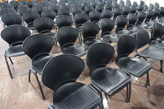 Chairs. Black chairs lined up in a conference room royalty free stock images
