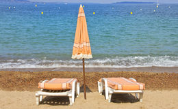 Chairs on a blue beach Royalty Free Stock Photography