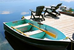 Chairs boat dock Stock Images