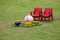 Chairs and ceramic tea set in garden Royalty Free Stock Images