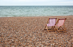 Chairs on cobbled beach Royalty Free Stock Photography