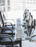 Chairs computers and headset in modern office Stock Photography