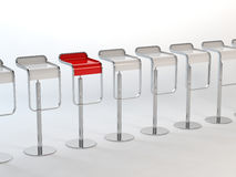 Chairs concept. 3D rendering of a white chairs and a red one Stock Photos
