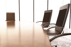 Chairs and conference table on the concrete wall Stock Photos