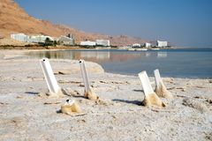 Chairs covered with salt in the Dead Sea royalty free stock photos