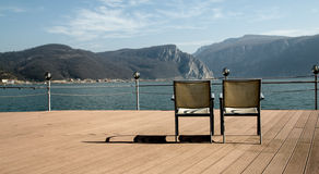 Chairs on Danube shore Stock Photos