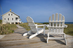 Chairs on Deck Facing Ocean Royalty Free Stock Photography
