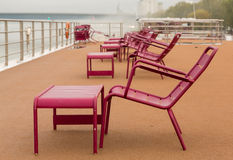 Chairs on deck of river cruise boat in rain Royalty Free Stock Photography