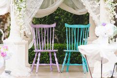 Chairs in Decorated Arbor. Two wedding chairs in decorated arbor stock photography