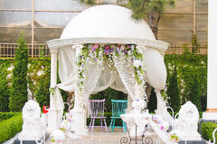 Chairs in Decorated Arbor. Two chairs in decorated arbor for wedding royalty free stock photo