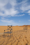 Chairs in the desert - Nonsense Stock Images