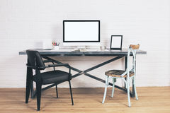 Chairs at designer desk Royalty Free Stock Photo