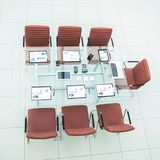 Chairs and Desk with documents and laptop for negotiations with business partners Royalty Free Stock Photos