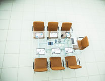Chairs and Desk with documents and laptop for negotiations with business partners Royalty Free Stock Photography
