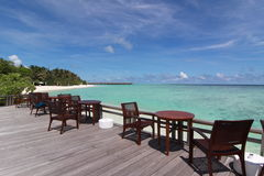 Chairs and desk near the beach, Maldives Stock Image