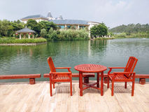 Chairs and desk near the lake. In summer Stock Image