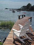 Chairs on dock. Chairs overlooking the water Royalty Free Stock Photography