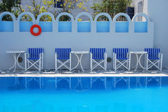 Chairs on the edge of a pool. Santorini Royalty Free Stock Photo