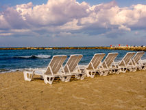 Chairs on an empty beach in Autumn Stock Image
