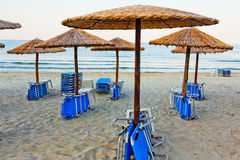 Chairs on empty beach Stock Photography