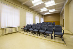 Chairs in empty conference hall Stock Photos