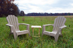 Chairs in Field. Two chairs and a table in a large field Royalty Free Stock Photos