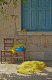 Chairs and fishing nets. A real greek picture with fishing nets and chairs Stock Photos