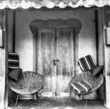 Chairs and front door stock photos