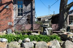 Chairs at the front door with small garden. On the blue sky Royalty Free Stock Images
