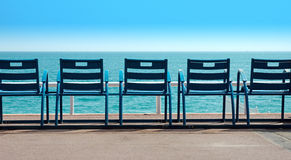 Chairs in front of the sea Stock Image