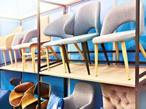 Chairs in furniture store stock images