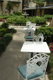 Chairs in the garden. Chairs and tables in an outdoor garden spot Stock Photos