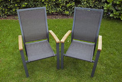 Chairs in the garden. Two chairs in the garden stock image