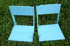 Chairs on grass Royalty Free Stock Photos