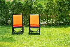 Chairs on a green lawn Royalty Free Stock Photos
