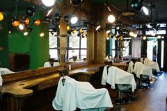 Chairs in green male barbershop in retro style.  Royalty Free Stock Photos
