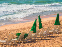 Chairs and green umbrella Royalty Free Stock Photo