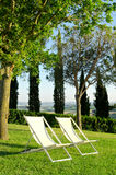 Chairs on a hill in Tuscany Stock Image