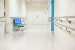 Chairs in hospital hallway Royalty Free Stock Photos