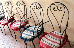 Chairs. Iron chairs with colorful cushions Royalty Free Stock Photo