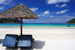 Chairs on an island beach. Chairs on a beautiful tropical island beach Stock Images