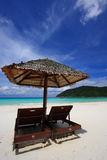 Chairs on an island beach. Chairs on a beautiful tropical island beach royalty free stock image