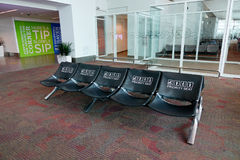 Chairs at KLIA airport, Malaysia. Chairs for passengers at KLIA airport in Malaysia. KLIA is the largest and busiest airport in Malaysia. In 2014, it handled 48 Royalty Free Stock Photos