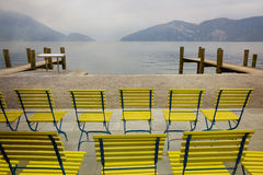 Chairs on lake Lucerne, Switzerland. Retro filter Stock Photo