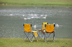 Chairs on lake side Royalty Free Stock Photography