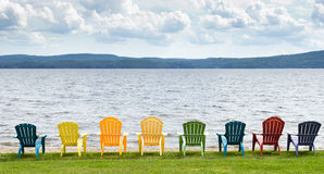 chairs lakeside Royaltyfri Foto