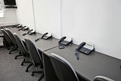 Chairs and landline telephones in television station Royalty Free Stock Image