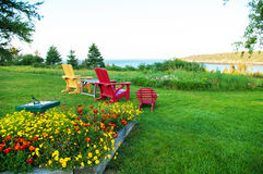 Chairs on the Lawn. At the Whale Cove Cottage Stock Photography